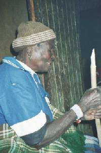 Matodzi tells a folk tale to her many grandchildren in her kitchen hut at Muswodi